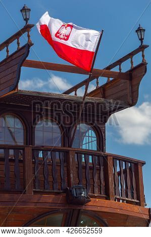 Swinoujscie. Polish Flag At The Stern Of The Old Ship.