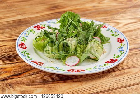 fresh salad on the wooden background