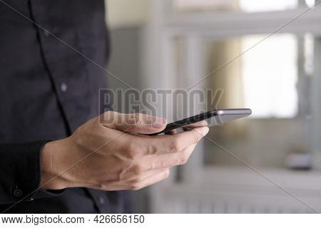 Close Up Of Man Using Mobile Phone.
