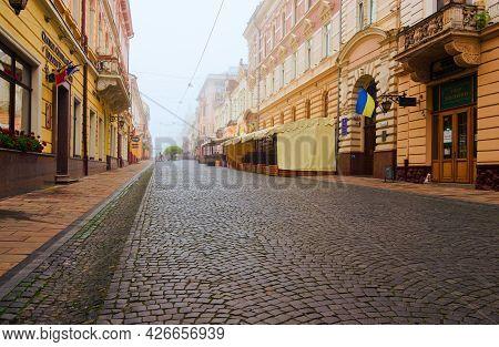 Chernivtsi, Ukraine-may 14, 2021:foggy Morning Landscape Of The Pedestrian Street Named Olga Kobylia