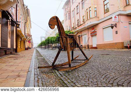 Chernivtsi, Ukraine-may 14, 2021:big Wooden Rocking Horse On The Pedestrian Street Named Olga Kobyli