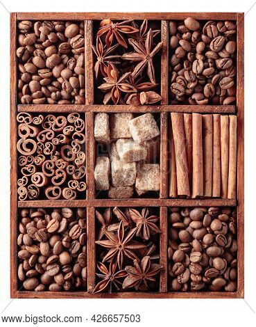 Roasted Coffee Beans, Cinnamon Sticks, Anise, And Brown Sugar In A Wooden Box. Isolated On White.