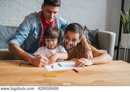 Gay Couple And Their Son Having Fun