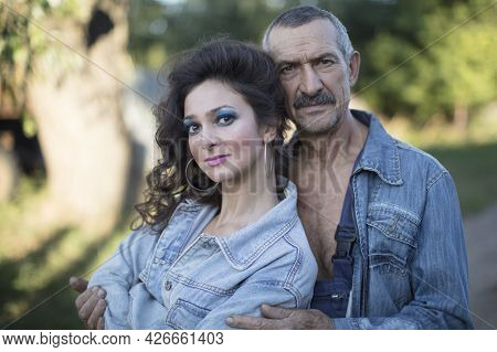 A Beautiful Adult Girl With Her Father. Father And Adult Daughter