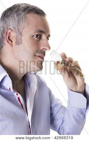 Man Smelling A Perfume