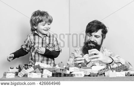Love Still Keeps Us Together. Small Boy With Dad Playing Together. Happy Family Leisure. Child Devel