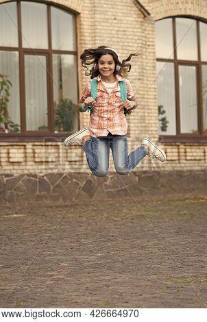 Happy Childrens Day. Energetic Child Jump In Schoolyard. School Education. International Childrens D
