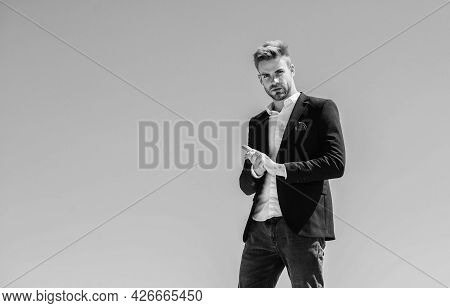 Young Entrepreneur Businessman. On Top Of World. Hipster With Beard. Businessman Against Blue Sky. F