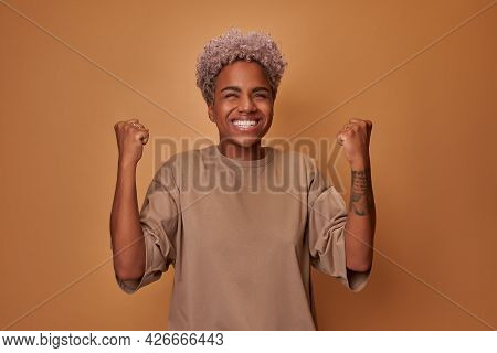African Woman Rejoices Winning Competition Makes Fist Pump With Closed Eyes