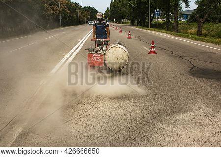 Dnepropetrovsk, Ukraine - 07.02.2021: Surface Preparation For Laying Asphalt Pavement. Removal Of De