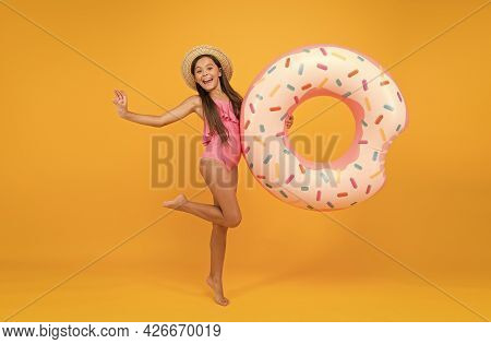 Summer Resort. Recreation Concept. Hotel With Swimming Pool. Little Girl And Swimming Donut Ring. Ki