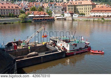 Prague, Czech Republic - July 23, 2019: Repair Barge On Vltava River. Renovation Of Charles Bridge.