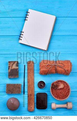 Blank Notepad With Aroma Spa Bath Accessories On Wood.