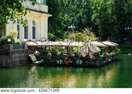 Outdoor Restaurant Terrace On Water Of Lake, Sunny Day, Scenic Summer Cityscape, Romantic Lifestyle,
