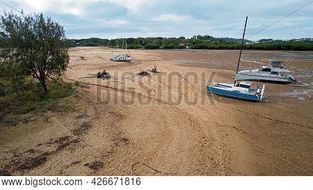 Mackay, Queensland, Australia - July 2021: Boats Moored In A Creek At Low Tide On Bucasia Beach