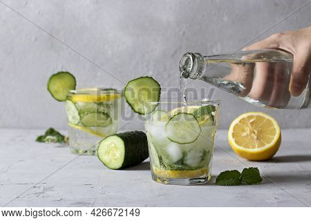 Two Summer Fresh Iced Drink With Mint, Lemon And Cucumber, Healthy Detox Mojito Cocktail On Light Gr