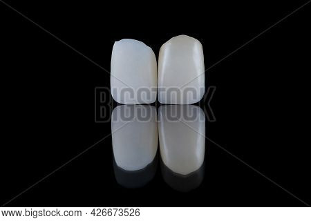 Close Up Artificial Lithium-disilicate Dental Crowns Of Central Incisors Unpainted And Painted.