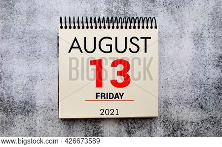Calendar With Text 13 August On Yellow Background And With A Vase Of Flowers