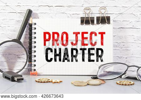 Project Charter On Sticky Notes Isolated On White Background
