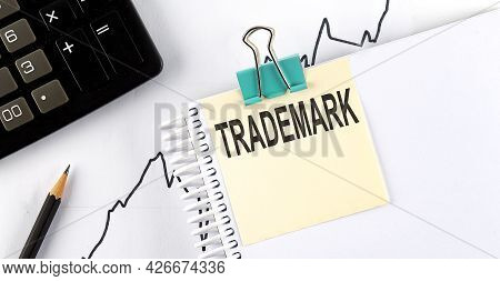 Stickers With Pencils And Notebook With Text Trademark On The Chart Background