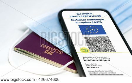 French Eu Digital Covid Certificate With The Qr Code On The Screen Of A Mobile Phone Over A Surgical