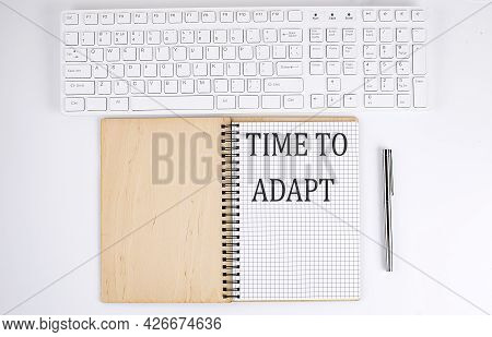 Time To Adapt Text On The Notebook With Keyboard On The White Background