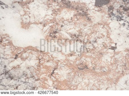 Pale Brown Marble With White Splashes, Close-up Of Polished Natural Stone Surface.