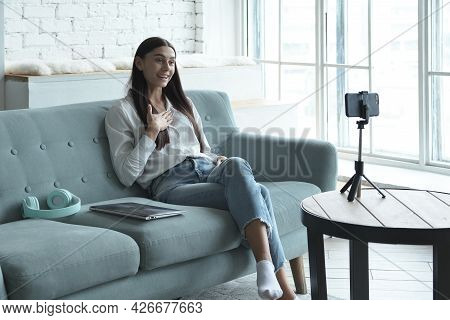 Female Vlogger Influencer Sit At Home Speaking Looking At Camera