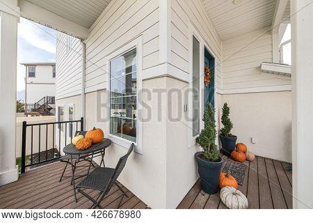 Small Veranda Exterior Of A House With Decorative Pumpkins