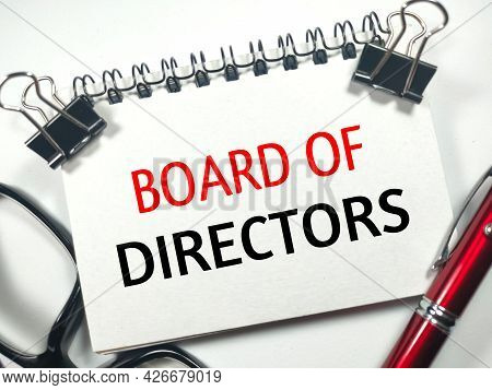 Business Concept.text Board Of Directors On Notebook With Paper Clips,glasses And Pen On White Backg