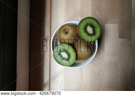 Healthy Kiwi Fruit In A White Bowl, Ripe Whole Kiwi And Half Kiwi, Selective Focus
