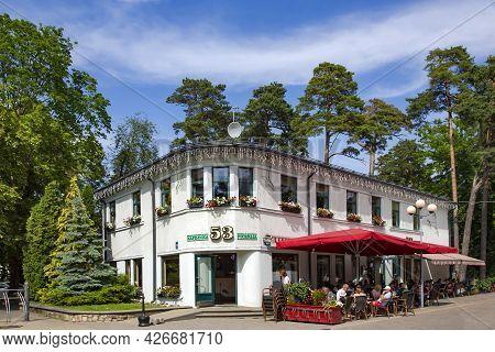 Latvia, Jurmala, July, 2021 - Cafe With An Open Veranda On Jomas Street In Jurmala, Latvia. Jurmala