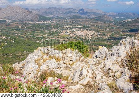 Small Town Of Parcent In Distant Flat Plains Between Mountains From Coll De Rates Range In Province