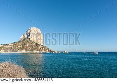 Prominent Landmark The Rock Of Ifach Jutting Out Into Mediterranean Sea At Calpe Spain.
