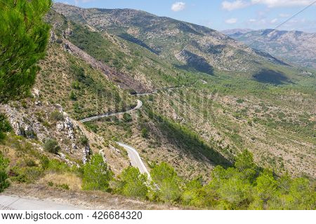 Winding Road And Agricultural Terraces Through Famous Mountain Range Coll De Rates In Province Valen