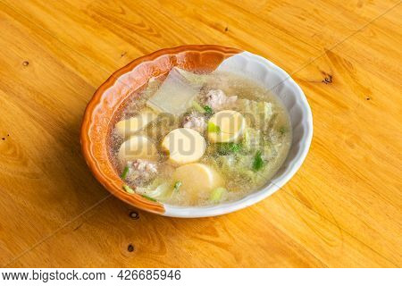 Clear Soup With Tofu And Minced Pork On A Wooden Table, Close Up And Top View.