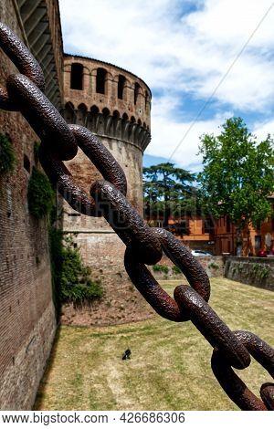 Drawbridge Chain Of The Castle Of Imola. Selective Focus. Bologna, Italy