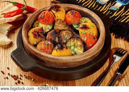 Tandoor Baked Vegetables In Wooden Bowl With Shotis Puri