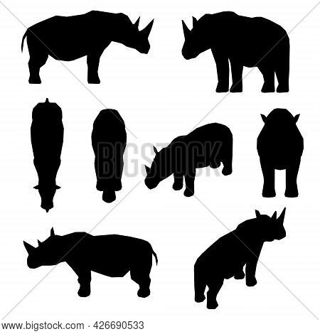 Set With Silhouettes Of A Rhinoceros In Different Positions Isolated On A White Background. Vector I