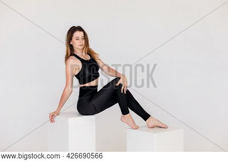 Athletic Young Woman Doing Yoga Practice Isolated On White Background. The Concept Of A Healthy Life