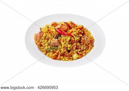 Pilaf With Lamb, Carrot, Raisins And Chili Pepper Isolated On White