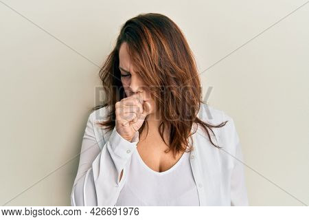Young caucasian woman wearing casual clothes feeling unwell and coughing as symptom for cold or bronchitis. health care concept.