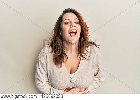 Young caucasian woman wearing casual clothes smiling and laughing hard out loud because funny crazy joke with hands on body.