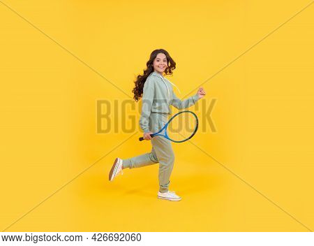 Happy Energetic Kid Jump In Sportswear With Tennis Racket Running To Success, Active Childhood.