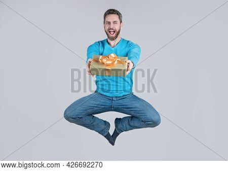 Energetic Happy Surprised Man Giving Present Or Gift Box, Surprise