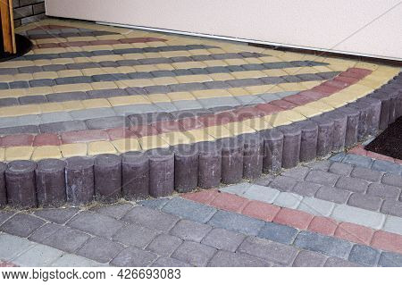 Porch Of A House Lined With Colorful Paving Stones Red And Browm