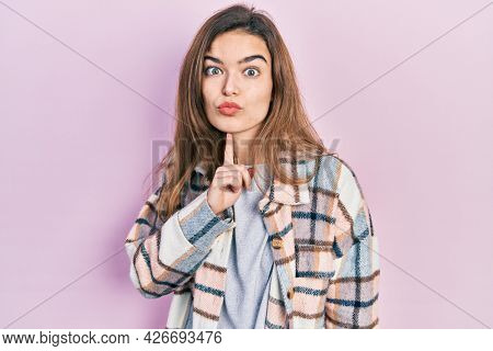 Young caucasian girl wearing casual clothes thinking concentrated about doubt with finger on chin and looking up wondering