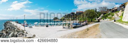 Old Town Of Nessebar, Bulgaria. Panorama Of South Beach With Pier At High Noon With Clouds On The Sk