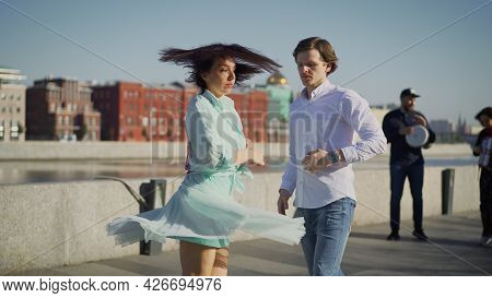 A Young Couple Dancing A Spanish Dance To Live Music. Young Couple Dancing Outdoors Under The Button
