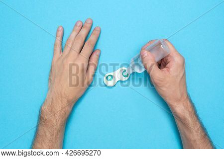 A Man Pours A Contact Lens Solution. Hygiene Of Colored Lenses. Health Care. Disinfection.
